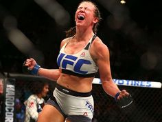 Miesha Tate chokes out Holly Holm in fifth for UFC women's bantamweight title