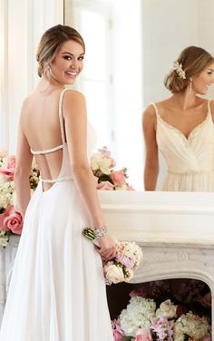 A Capri chiffon sheath dress with Grecian trimmings from Stella York features a beaded sweetheart neckline, shoulder straps, belt, and back details.