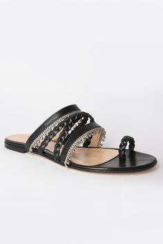 """For evening, Gianvito Rossi offered what he called a """"bling alternative with an Istanbul mood,"""" like these black-and-silver chain sandals."""
