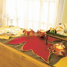 It's easy to craft a no-sew table runner in the shapes and colors of fall: http://www.bhg.com/thanksgiving/indoor-decorating/centerpiece-and-tabletop-decoration-ideas-fall/?socsrc=bhgpin112414fallleaftablerunner&page=8