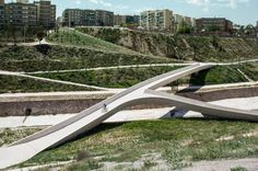 The scheme by Grupo Aranea reconnects the two sides of a concretized river with a network of paths and bridges based on the most popular routes suggested by resid...