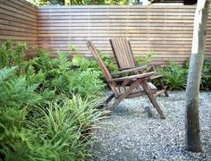 Modern Courtyard Garden Seattle Adirondack Chairs Cedar Fence Decomposed Granite  Ferns Grasses