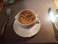 Light pumpkin bell pepper foam soup with roasted pumpkin seeds @ Restaurant Bellevue