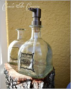 Camelot Art Creations: Up-Cycled Soap Dispensers { Patron Bottles }    This site doesn't explain how to make them but it looks like you drill a hole through the cork to insert the pump.