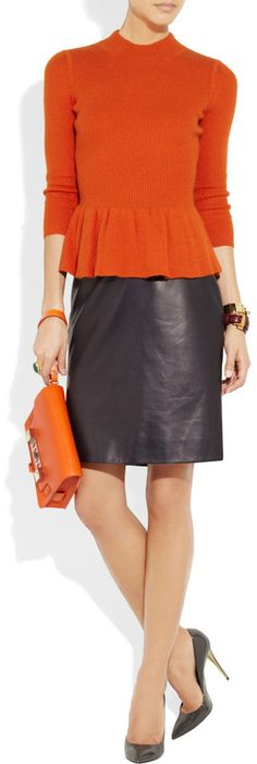 Lovely orange peplum sweater by Tory Burch. I want a leather skirt!