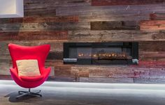 One of our favourite feature walls by a client - this was part of a modern basement reno.  They used our classic grey rustic brown and faded red reclaimed barn board.  The LED strip lighting cool fireplace and brightly coloured chairs make this a very cool space to entertain friends and family.  What do you think?  #featurewall #rusticwall #barnboard #barnwood #barn #reclaimed #modern #reclaimedwood #rustic #rusticwood #igers #toronto #hamilton #hamont #tdot #the6ix #905 #cottage #muskoka…