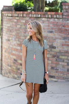 A NRFB favorite, this chic off-duty dress is designed with a rounded neckline, an allover striped print pattern and a relaxed silhouette for a classic look. Wear this modern piece with your most-loved