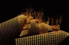 """A trippy beer pong table complete with lights and infinity mirrors to """"create the illusion of endless space."""" 
