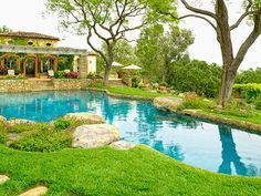 "More of ""The Chipmunks"" creators home...Luv this house....The blue swimming pool is surrounded by boulders and a lovely waterfall"