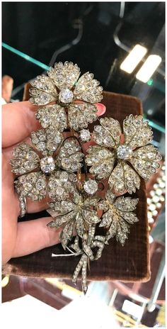 A fantastic antique diamond flower brooch. Seen at Faerber NY at the Original Miami Antique Show. #DiamondBrooches #AntiqueJewelry