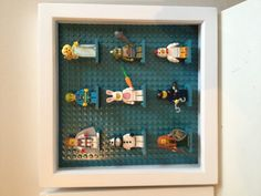 Lego mini figure display. Deep frame, lego building plate and figure base plates painted to match sitting room decor. Done.