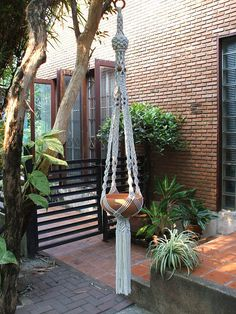 """Wonderful design of Macramé Plant Hanger in traditional style Persia, perfect for 9-11"""" (diameter) plant pot. The hanger is made of white bleached poly cotton (cotton + polyester) twisted cord and wooden beads. Plant pot not included. Size: 65""""(165 cm) overall length (top of the hanger to end of its tassel) We also have natural white (unbleached) poly cotton for your choice, just let me know whenever you order. Please note the item is made to order therefore it will be shipped within 7-10…"""