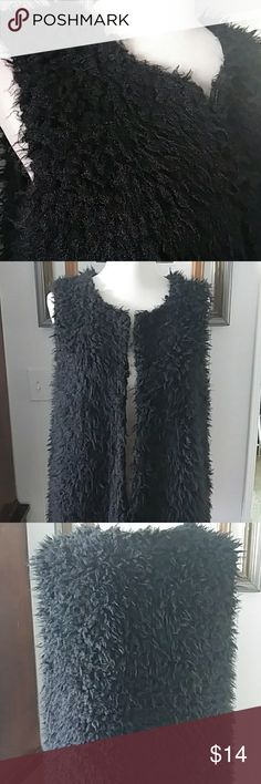 Black Vest Fluffy Black Vest great condition . 28 in long. Great condition. Hook and eye closure.  Lightly used. Jackets & Coats Vests