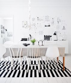 Black-and-white modern and minimalist dining space with a striped carpet