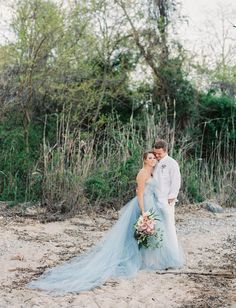 East Made Event Company Maryland Coastal Inspiration Styled Shoot as featured on Green Wedding Shoes. Photo by CJK Visuals, Blue Oceane Wedding Dress by Carol Hannah. Beach wedding inspiration. Bouquet by Mobtown Florals.