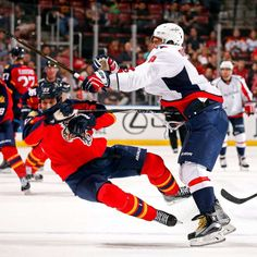 Move out  Alex Ovechkin of the Washington Capitals collides with Willie  Mitchell of the Florida de5996e4320e