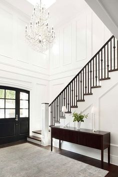 I do not think you can go with a larger newel post. However I like the idea of the stained treads + handrail + cap on the newel post. Keep the newel post + tread + stringer (trim) white. This will look sharp!