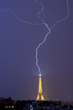 Lightning hits the Eiffel Tower in Paris, France. The Lightning came from the ground what makes it even more special and rare.