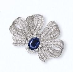 A SAPPHIRE AND DIAMOND BROOCH #GemstoneBrooches
