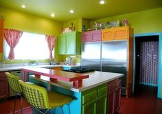 I love the bright colors. My dining room walls are the same color green and I'm trying to decide what to paint my table and chairs. Hmm...