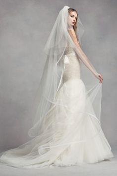 b5e101dc6fb6 A softly layered border gives this two-tier tulle veil from White by Vera  Wang