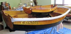 """Mark C built these two beatiful Prams. One an Eastport Pram Dinghy """"Cosmo"""", the other a Cradle boat or Baby Pram (1/2 scale) with a coffee table option. The CLC Cradle Boat: Build Your Own Baby Cradle!"""