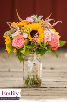 Sunflower and Coral Roses bridal bouquet / http://www.himisspuff.com/summer-wedding-ideas-youll-want-to-steal/6/