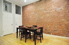 Dining Room w/ Brick Accent Wall