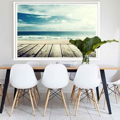 For coastal scenes to soothe your aesthetic opt for the photographic Malibu Framed Print from Hoxton Art House. Style Tropical, Coastal Style, Coastal Decor, Modern Coastal, Coastal Living, Dining Room Furniture, Dining Chairs, Minimalist Dining Room, Boho Home