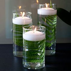 FiftyFlowers.com - fern in water with floating candle on top. Great centerpiece idea! #floatingcandles
