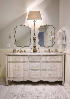 A vintage French provincial dresser serves as a double vanity in the upstairs bathroom of the historic 1930 home.  The RESTORIC Designs owner ensured that the quartz top was cut with the same curved lines as the original wood top, lending a custom furniture feel.  Cozy residence shines with great details | Dallas Morning News (Photo: Kye R. Lee)