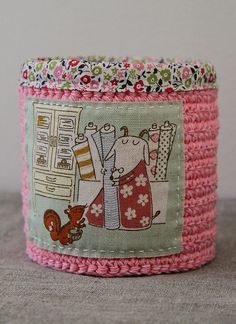 Love this fabric and crochet basket.  You could put labels on them...make lids, etc.  Awesome!