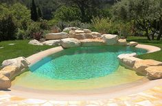 small beach entry pool with rock surrounds is great for a small backyard