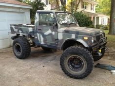 Camo Suzuki Samurai... love how they modified it and turned it into a beast.. maybe another 3 inches with wider tires...