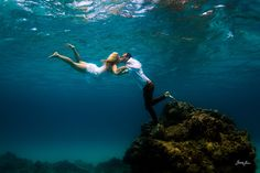 Logan + Sara. Post wedding underwater session.  Kona, Hawaii.