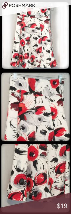 Sassy Crisp Lined Skirt Black White Red by DeCo LG Sassy cotton blend skirt by DeCo. The colors are vibrant and contrast with the crispy white. Reds, blacks and grays are in a sassy floral design with an eye catching appeal. This skirt is fully lined and in excellent condition ready to wear! Deco Skirts A-Line or Full