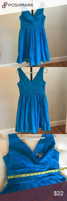 DKNY cotton dress DKNY cotton dress. Pretty turquoise dress for the summer. Fitted bodice with flattering v front and back. So pretty. Never worn, but no tags. DKNY Dresses