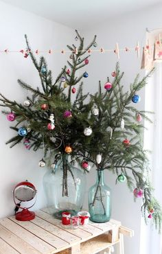 Put branches in a vase. see more at http://blog.blackboxs.ru/category/christmas/