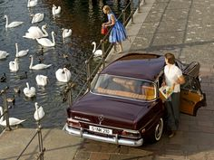 Mercedes Fin Tail Sedan and swan girl
