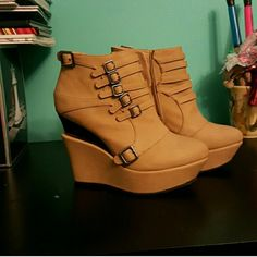 Wedge tan boots ankle platform Only worn a few times, and has scuff marks show in the last image. True color is better shown in the last image. Shoes Ankle Boots & Booties