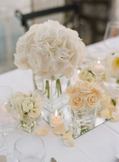 I love this romantic centerpiece -- White and Pale Peach Flower Arrangements in Clear Glass Vases