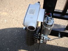 Automated Gate by The Gate -- Homemade automated gate mechanism fashioned from a surplus geared motor and featuring a sealed ball bearing between the drive output and the chain. http://www.homemadetools.net/homemade-automated-gate