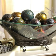 Timeless and chic, our Oversized Bronze Bowl is the perfect centerpiece for any table! Crafted of glass and metal, its clear finish makes it perfect to display orbs or other decorative items!