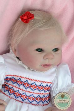 "Little Miss KAIDENCE is a preemie baby I just completed. She is just 16"" long and weighs a whopping 2 lbs., 9 oz. She has beautiful emerald green German glass eyes and soft Delta Dawn hand rooted hair. She was a custom order and lives in LETHBRIDGE, CANADA.  See her at www.heartstringsnursery.com."