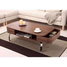 The Berkley wooden coffee table, by Furniture of America, features a mid-century modern inspired silhouette with smooth, curved lines and shiny chrome legs. The removable side pocket drawers can double as serving trays while entertaining.