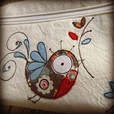 applique and embroidery on a small bag.