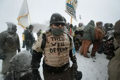 Despite blizzard conditions, military veterans who say they support the pipeline protesters marched Monday near the Standing Rock Sioux Reservation.