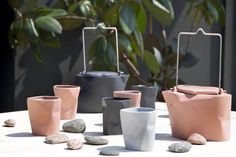 This collection of bent vases and cups has been in existence since 1995, and here you find the newest version of this popular series – a bent tea set made of colored porcelain. The set includes a teapot and four cups. It is available in two colors of matte porcelain (black and pink). This new edition adds a warm atmosphere to your daily cup of tea.MATERIALColored matte porcelainDIMENSIONSTea pot – 350 ml + 4 cups - 100 mlMade with love by Modus Design, Poland Porcelain Black, Popular Series, Tea Set, Kitchenware, Tea Cups, Planter Pots, Deco, Instagram Posts, Pink