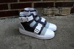 Solid straps and blends of blue set off the adidas SLVR Buckle High Top. An  above ankle cut compliments a progressive design on this fashion forward  model, ...