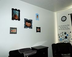 New born Pictures in painted Frames to match our son's Black and white nursery with blue and grey accents.